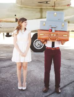 love these stacks of vintage suitcases the groom is holding!