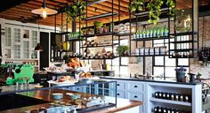 The shaker style cabinets and metal rails that are basically a dream kitchen at The Grounds of Alexandria in Sydney. | 31 Coffeeshops And Cafés You Wish You Lived In