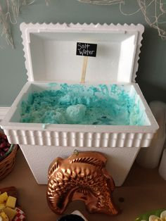 "Fishing theme baby shower punch served in a styrofoam cooler. Sprite, Blue Hawaiian Punch and Vanilla Icecream. Makes a frothy ""sea foam"" for ""Ocean Water"" punch!!  Thanks to my best friend for this awesome idea!!"