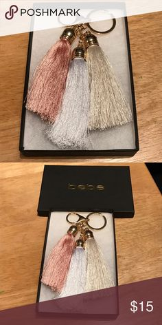 Bebe multi color key ring Multi color BeBe key ring. Brand new never used. Just been sitting in the box. The box is included. Colors are a rose pink, white, and off white/champagne. bebe Accessories Key & Card Holders