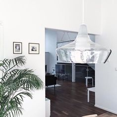 Concrete and glass hanging lamp in a living room Laaka - Design Laura Väre