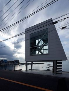 """"""" Window House Yasutaka Yoshimura Architects """"A weekend house facing to the Sagami Bay with view to Mt. Fuji and Enoshima. The site is just 3 x with of footprint, and the building has become. Weekend House, Huge Windows, Story House, Less Is More, Coastal Homes, Brutalist, Architect Design, Around The Worlds, Exterior"""