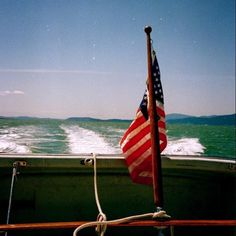 Happy 4th of July!  A favorite shot from a sunny cruise on Bellingham Bay.  This is a scan from one of my many boxes of printed photos before digital devices lived in our pockets. Who's ready to look for their old film cameras?! #unfiltered #filmphotography #4thofjuly #bellingham #boatinglife #pnwlife
