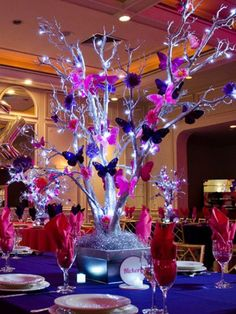 Butterfly tree quinceanera decorations tree centerpieces butterfly centerpieces butterfly theme butterfly wedding outdoor venues are a fantastic alternative to a conventional hall or ballroom a butterflytree Butterfly Centerpieces, Wedding Centerpieces, Wedding Decorations, Quinceanera Centerpieces, Candy Centerpieces, Glitter Decorations, Butterfly Decorations, Manzanita Tree Centerpieces, Purple Centerpiece