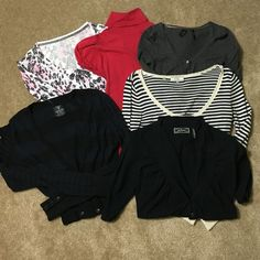 Bundle of 6 Guess Sweaters/Tops 6 Excellent condition Guess Tops and light weight sweaters!!! The 2nd pic shows a red turtleneck short sleeve top. Has a wrap for around the waist. Can be tied. The back has a cute circular opening right below neck. A long sleeve pink, white & gray button down thin sweater. 3rd pic shows a gray crop thin sweater w buttons and a second one that is blue and cream w strips. Last is a navy and black striped long sleeve thin sweater and a black above the elbow thin…