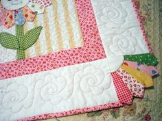 The beautiful colourful baby quilt. The patchoworking