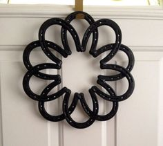 Medium Sized Horseshoe Wreath made with 10 new, steel horseshoes. Approximately 14 across in every direction. The wreath pictured is black in