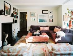 cozy and eclectic. love the huge bench/coffee table/foot stool in the middle!
