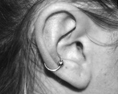 i want this. to make my ear piercings look a little more balanced. i have 6 on one ear and 3 on the other :/
