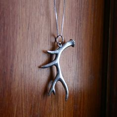 Click to read the special meaning of deer antlers!   This sterling silver charm necklace is a sterling silver deer antler pendant on a sterling silver chain. Show off your woodsy side!
