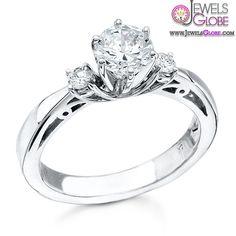 14kt white gold ring highlights three diamonds