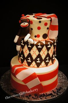 Love the socks as a fun added touch on this sock monkey themed birthday cake.
