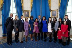 President Barack Obama, first lady Michelle Obama, and daughters Sasha and Malia, center, join their extended family for a group photo in the Blue Room of the White House on Inauguration Day, Sunday, Jan. 20, 2013. Joining the First Family from left are: Craig Robinson, Leslie Robinson, Avery Robinson, Marian Robinson, Akinyi Manners, Auma Obama, Maya Soetoro-Ng, Konrad Ng, Savita Ng, and Suhaila Ng.