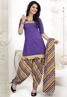 Appeal to your refine taste with this Purple #Color Cotton Designer Patiala #SalwarKameez which is accompanied with a printed dupatta and bottom. The suit features lace embellished yoke and border along with abstract print.