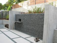 modern outdoor pizza oven built into gabion wall, modern design style, outdoor cooking