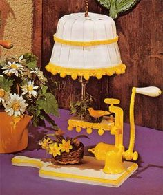 """""""It's a canary-yellow meat-grinder mounted on a cheese board. A small landing has been built for a fake bird. The landing is fringed with hanging balls. (As is so often the case.)"""""""
