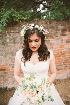 Fresh flower accents for hairstyles are so gorgeous and a great add for a flowy dress!