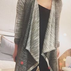"""grey two toned cardigan Draped collar grey knit two toned cardigan. I just love this! So classic yet fun. This listing is for a M (also available in small). New retail. No trades!    • S: length 28-33"""", armpit to armpit 19"""", sleeves 24""""  • M: length 29-34"""", armpit to armpit 20"""", sleeves 25""""  • 44% cotton, 56% polyester Sweaters Cardigans"""