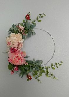 Charming embroidery hoop wreath, Hello amazingly cute wreath! I am seriously in love with this wreath. Borderline obsessed. They would look amazing above your fireplace, on your front door, in a child's bedroom, or anywhere really!Theyve recently become popular for spring and summer