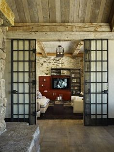 eclectic media room by WORTH Interiors - floors and doors