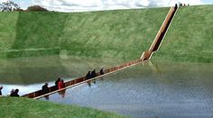 Moses Bridge  This sunken bridge designed by Ro & AD Architects from the Netherlands, has in fact parted waters. The bridge is in the Netherlands and it is the most practical and fun way of accessing the stunning 17th century fortress.