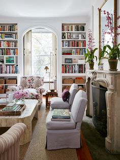 My apartment | McGrath II Blog - love the idea of slipper chairs on casters to use in front of fireplace flanked by bookcases and desk
