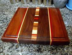 "Handmade Medium Wood Cutting Board - For The Foodie - Peruvian Black Walnut, Mahogany, Curly Maple, and Bloodwood Laser Engraving Now Available!!! Included in price! This board will make you melt! * * * Made To Order * * * Made To Order Items can take up to 21 business days to complete. This does not include shipping. All Items are handmade to order. Dimensions: * 10"" X 13"" X 1 1/8"" * Feet Optional Types of Wood: Black Walnut (Peru) Curly Maple (Massachusetts) Mahogany (Honduras) Bl..."