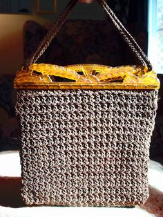 1920s Beige crochet handbag with carved amber lucite frame.