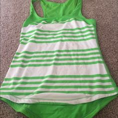 Lululemon tank top Great condition however has barely noticing everyone stains (shown in third pick) fits size 4-6 25% off bundles limited time lululemon athletica Tops Tank Tops