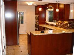 Shaker Heights OH Kitchen Remodel: Cherry cabinets, travertine tile flooring, slate backsplash, stainless steel appliances, granite, crystal lighting
