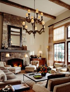 South Shore Decorating Blog: love the window treatment, beams, fireplace, and how to handle a room with high ceilings