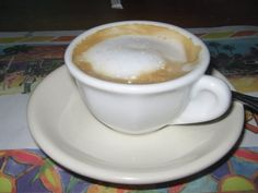 """Cortadito, - Cuban Cortadito, which in Spanish literally means """"small cut"""", is an espresso topped with steamed milk. It can be between 50/50 to 75/25 espresso and milk. It is similar to a cortado served in other countries, but pre-sweetened."""