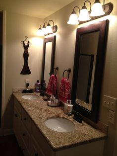 Beige Granite, White Cabs, Dark Mirror Frame, Oil Rubbed Bronze Hardware  Like The