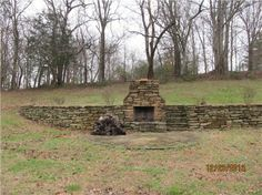 Outdoor fireplace cut into hill