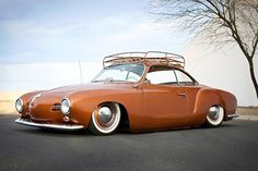 59 VW Karmann Ghia. My beloved grandmother had one & I'd drive it when I visited her in San Francisco. She was such a lady.