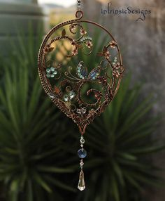 / sun catcher / intrinsic designs /