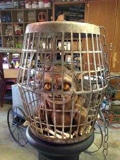 Find a scary creature, and trap it between 2 laundry baskets that have been spray painted to faux metal, use some chain to hang it from the ceiling and you have yourself a new pet. #diyhalloweendecorations