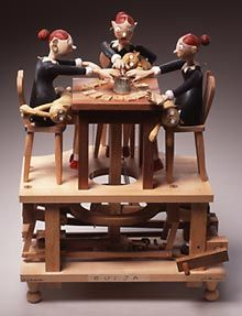 Mechanized sculpture of three women working Ouija with a glass and surrounding alphabet. By Cabaret Mechanical Theater