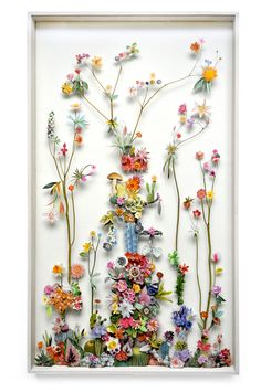 Dutch artist Anne Ten Donkelaar designed these detailed flower compositions with pressed flowers and paper cutouts creating 3D gardens as an art piece