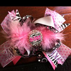 Over the top BRAT bow. Visit www.facebook.com/MandMinthemirror or contact me directly at Jodig1223@aol.com