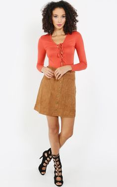 Slip into a soft long sleeve jersey knit lace up bodysuit for a simply gorgeous Fall look. Pair with a trendy suede skirt. I MakeMeChic.com