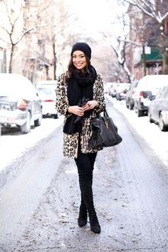 Kat Tanita is wearing Stuart Weitzman over the knee boots with a leopard print Topshop coat