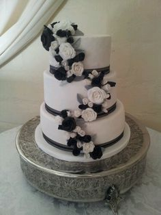 Black, white and silver wedding cake with an ornate Polished Silver #CakeStand