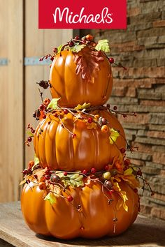 Make this stacked fall pumpkins projects it is a fun and cute DIY pumpkin decor craft.