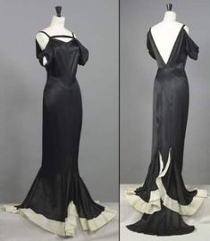 historic Chanel haute couture Cannes gown from circa 1935.The long black silk dress features a unique neckline and puffed sleeves hanging halfway down on the shoulder.