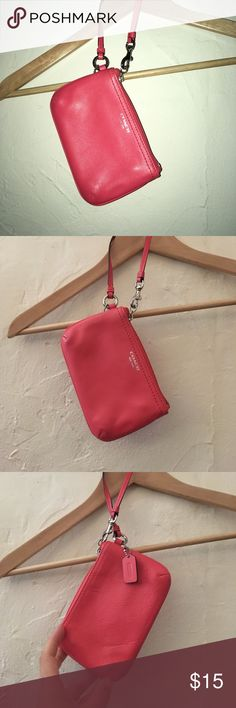 Coral pink coach clutch Small coach clutch in a bright coral pink. Gently used in good condition. Coach Bags Clutches & Wristlets