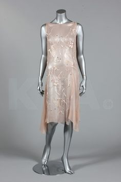 A floss silk embroidered pale pink chiffon cocktail gown, circa 1927, embroidered in pastel to ivory silks with stylised blossom and palmettes,with pearlised bugle beads and scattered with rhinestones
