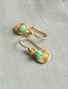 I have wire wrapped stunning Amazonite roundels to dangle from an artisan hammered 16k gold plated circle charms.  These earrings are finished onto 24k gold over sterling silver vermeil earwires and measure approximately 1 in total length.  Thank you for looking