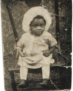 Child of sharecroppers...dressed in fine Sunday attire.