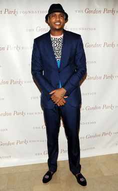 Carmelo Anthony from Best Dressed NBA Players  This blue look is about as melo as can be. From the smoking slippers to the cool blue suit to the smart hat, the Knicks forward is slick at an event in NYC.